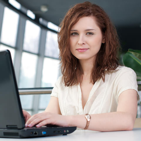 http://www.dreamstime.com/royalty-free-stock-images-young-business-woman-laptop-image22966779